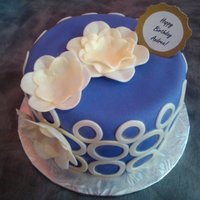 Purple Birthday Cake  Made this birthday cake for a friend of a friend, and her favourite colours were purple and gold. I used gold luster dust on the flowers...