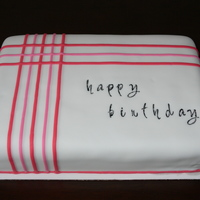 Pink Striped Birthday Cake  A 9x13 quarter sheet birthday cake. Vanilla chocolate chip cake with chocolate buttercream. Simply decorated with pink stripes from my clay...