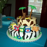 Jungle Theme buttercream icing , fondant animals . pretzel rod for tree trunk and royal icing top