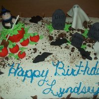 Halloween half choc half white buttercream fondant witch . pumpkins. ghost and gravestones