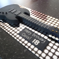 Black Electric Guitar Cake !8th Birthday cake modelled on an ESP Viper 500 electric guitar. Made from choc mud and vanilla with dark choc ganache and fondant icing