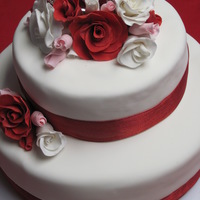 Valentine Cake First time making fondant roses and first time doing a stacked cake with fondant. Made this cake for church party on Valentine's Day,...