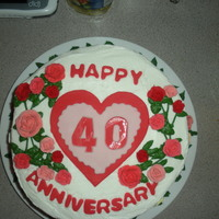 40Th Anniversary Cake I made this cake for a coworker's parents 40th Anniversary which is on Valentines Day. I think I over did it with the roses, but they...