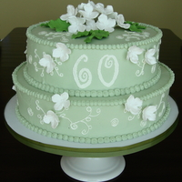 60Th Anniversary Swiss meringue buttercream frosted cake with gumpaste hydrangeas sprayed with edible luster dust.