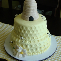 "My Take On Martha Stewart's ""beehive Cake"" This was designed for a bee themed bridal shower. Handmade gumpaste and fondant beehive, bees and flowers."