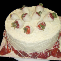 "White Chocolate Cake With Strawberrys 10"" Round White Cake. Filled with White Chocolate Ganache, Covered with White Chocolate BC, and finished with White Chocolate dipped..."