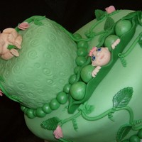 Sweet Pea The extra small cake on top is supposed to be saved for the babies 1st birthday much like the top tier of a wedding cake is for the 1st...