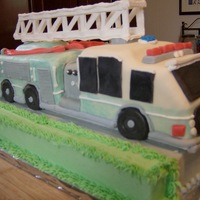 Fire Engine Cake Tough cake to make. Used royal icing for the ladder. UNC colors