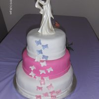 Wedding Cake Number 2 Satine Ice fondant withe gumpaste butterflies. Marble cake inside covered with buttercream frosting