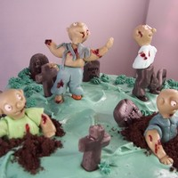 Zombie Cake The fondant zombies are coming! Zombies emerge from a pumpkin cake graveyard to help celebrate a 40th birthday.