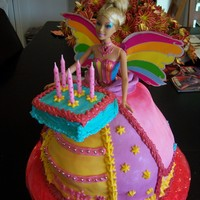 Barbie Cake This cake included the gift for the birthday girl - a rainbow fairy Barbie. I matched the Barbie's dress colors for the ball gown and...