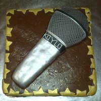 Microphone fondant covered sculpted microphone on chocolate BC, fondant star cut-outs