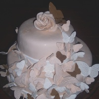 Butterfly Bridal Shower ivory colored white chocolate fondant, gumpaste butterflies & rose(forgive the blemishes--the customer carried the cake inside on a...
