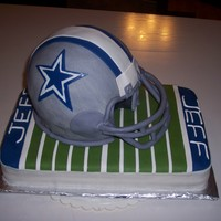Cowboys Helmet sculpted helmet, all fondant with GP mask. Had issues with the bottom of the helmet wanting to fold and wrinkle, but was able to smooth it...