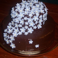 Chocolate Flower Cascade 80th birthday cake for a dear family friend (inspired by several fellow CCers...thanks all!) chocolate ganache with simple MMF flowers