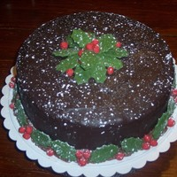 Snowy Holly dark chocolate ganache, MMF holly berries & leaves. I decided after taking this picture that I had too much PS 'snow,' so I...