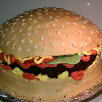 Hamburger buttercream, patty is chocolate cake, lettuce and tomatoes are candy clay