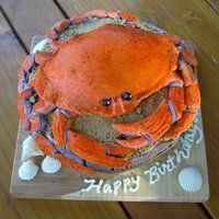 "Crab Cake  Dungeness Crab rests on a weathered wooden ""bucket"" filled with sand. Choc cake, graham cracker sand, fondant and sugar paste..."