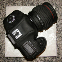 "Canon Camera   4 layer chocolate cake with choc buttercream. Fondant icing, small details done in modeling chocolate. Cake board is 12"" square"