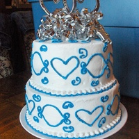 Hearts Of Love All buttercream. This was for a bridal shower. Her colors were Royal Blue and Silver.