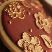 Gold Brush Embroidery This cookie is decorated in royal icing and gold pearl dust.