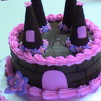 Chocolate Princess Castle This was a simple princess castle for a 3 year old chocolate lover. Dark chocolate cake with hot cocoa fudge icing. Fondant accents.