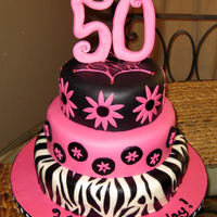 50Th Birthday Zebra And Hot Pink   This is a fondant over buttercream birthday cake, w/6-8-10 inch cakes. Gumpaste/fondant number topper.