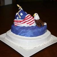 Flag And Eagle 2-layers chocolate cake are stacked and carved in different sizes. The flag is a carved triangle shape of madeira cake. Decorations are...