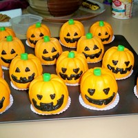 Jack-O-Lantern Mini Cakes These cakes were made from fresh pumpkin and chocolate chips crumb coated in creamcheese icing then covered in marshmellow fondant. All the...