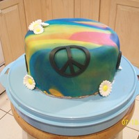 Tie-Dyed Cake Tie-dyed fondant with candy daises & fondant peace signs.