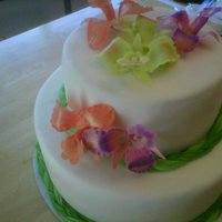 Orchid Wedding Cake This is a fondant covered cake with gum paste orchids.