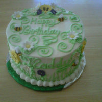 Maddy's Birthday Cake Coconut cake with mango mousse filling and vanilla buttercream frosting with gumpaste flowers and moulded sugar bees.