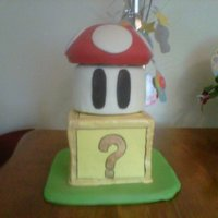 Mario Bros Cake   Fondant covered cake painted with luster dust and food coloring.