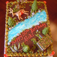 Hunting Themed Birthday Cake  From scratch yellow cake with double chocolate filling and frosting. Fondant and gumpaste accents are the hunting blind, deer, fish,...