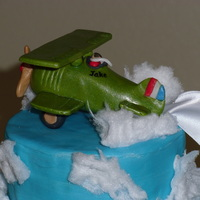 Airplane Baby Shower Cake Moist, from scratch, red velvet cake with cream cheese filling and frosting. Fondant airplane (Curtiss Jenny biplane) towing a banner that...