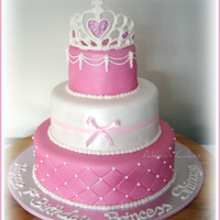 Pink Princess  1st birthday Princess 3 tier cake. The bottom tier is a 10 inch vanilla sponge rainbow cake with vanilla buttercream, the middle and top...