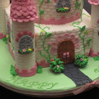 Enchanted Castle This cake was for a 5 yr old. It's all buttercream with fondant accents. Thanks for looking. :)