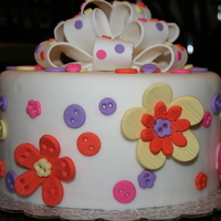 Flowers & Buttons Oh My! Practice cake for a Wilton Instructors training seminar...so much fun!