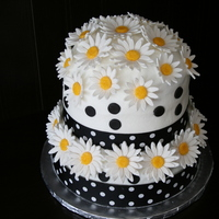 Everything's Coming Up Daisies! My first tiered cake - commissioned for a very special lady's 80th Birthday party with 40 attendees. I can't even tell you how...