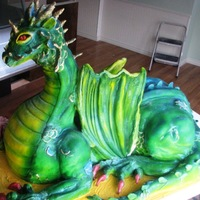 Dragon Cake This cake is 21/2 feet tall by 31/2 feet long. Wings are made of modelling chocolate and fondant. Cake was made for a large local event.
