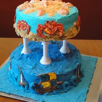 Sand & Sea Two tier cake with sailing ships and crabs made from color flow and sea shells made from gum paste. The sailing ships and sea shells were...