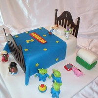 Toy Story Everything is edible except for Buzz and Woody. I made my own template for the head and foot board. I used some of the cake photos from...