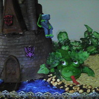 Castle And Dragon Cake   A little more touch up to do, but close to finish. Wilton castle cake and horseshoe pans. Thank you to osman1989 for your inspiration.