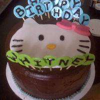 Hello Kitty Birthday Cake Mocha Espresso Cake w/ Espresso Liquor inside layered and frosted with a Chocolate Ganache. Hello Kitty face and Candy Lollies are all...