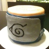 Naruto Birthday Orange and Blue MMF fondant-- fresh mango puree pound cake with whipped cream and fresh mango and mango pudding filling; three layers of...