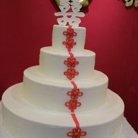 Double Happiness Wedding Cake 4 tier chinese themed wedding cake for my aunt lisa's wedding 4/17/10 the cake tiers are covered in white vanilla fondant, the double...