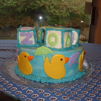 Ducks With Umbrellas This cake was for my best friend's first baby shower. The inspiration came from several pics of cakes I saw online. This was my first...