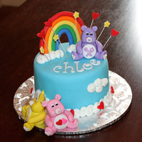 Care Bear   6 inch cake, handmade fondant characters and decorations.