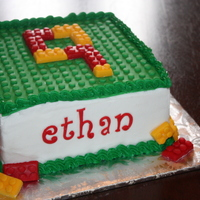 Lego   8 inch square cake decorated to mimic legos.
