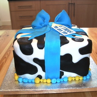 Christening Cow Cake Vanilla sponge with butter cream and strawberry jam. All fondant decoration.